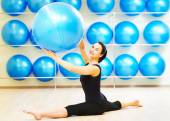 Split stretching exercises with fitness ball — Stock Photo
