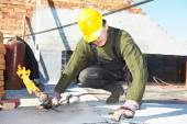 Flat roof covering works with roofing felt — Stock Photo