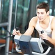 Man doing cardio training on machine — Foto de Stock   #71217927