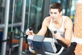 Man doing cardio training on machine — Stock Photo