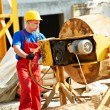 Builder worker at construction with mixer — Stock Photo #73143663