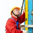 Builder worker at construction site  — Stock Photo #75471433