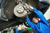 Auto mechanic at car brake shoes examining — Stock Photo