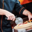 Pizza preparartion - cutting — Stock Photo #75720893