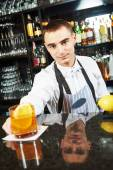 Bartender worker at bar with coctail — Stock Photo
