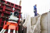 Surveyor equipment at construction site — Stock Photo
