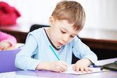 Child boy studying writing — Stock Photo