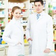 Two Pharmacy chemist workers in drugstore — Stock Photo #76720579