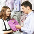 Man and assistant at apparel clothes shopping — Stock Photo #76720617