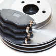 Two silver brake disks and pads — Stock Photo #59537631