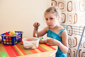 Girl eating porridge — Stock fotografie