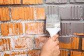 Human hand with painting brush — Stock Photo