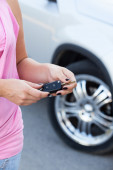 Woman with ignition key — Foto Stock