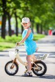 Girl riding on small bicycle — Stock Photo
