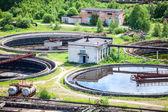 Round settlers at sewage treatment plant — Stock Photo