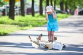 Young girl crying after falling down from bicycle — Stock Photo