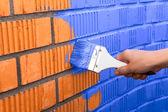 Human hand painting wall — Stock Photo