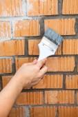 Starting to paint brick wall — Stock Photo