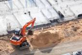 Orange excavator on foundation works — Foto Stock