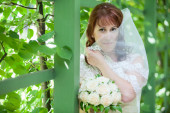 Caucasian bride in white dress — Stock Photo
