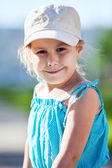 Happy smiling girl in blue dress — Stok fotoğraf