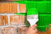 Hand with paint brush — Stock Photo
