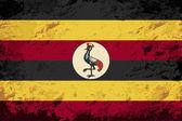 Ugandan flag. Grunge background. Vector illustration — Stok Vektör
