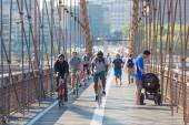 NEW YORK, USA - AUGUST 25, 2014: People cycling and walking on B — ストック写真