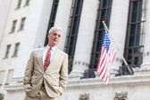 Senior Businessman in front of Wall Street Stock Exchange — Stock Photo