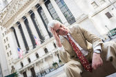 Sad Businessman in front of Wall Street Stock Exchange — Stock Photo