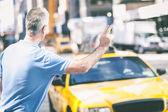 Senior Man Calling a Cab in New York — Stock Photo