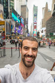 Young Man Taking Selfie in Times Square — Stock Photo