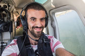 Young Man Taking Selfie in Helicopter Cabin While Flying — Stock Photo