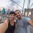 Young Couple Taking Selfie on Brooklyn Bridge — Stock Photo #52812755