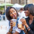 Two Beautiful Black Woman Enjoying Refreshing Drinks in New York — Stock Photo #53295381