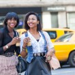 Two Beautiful Black Woman Enjoying Refreshing Drinks in New York — Stock Photo #53295395