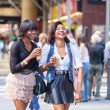 Two Beautiful Black Woman Enjoying Refreshing Drinks in New York — Stock Photo #53295397