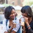 Two Beautiful Black Woman Enjoying Refreshing Drinks in New York — Stock Photo #53295399