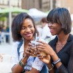 Two Beautiful Black Woman Enjoying Refreshing Drinks in New York — Stock Photo #53295405