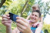 Father and Daughter Taking a Selfie — Stockfoto