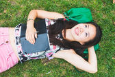 Asian Girl Laying Down on the Grass at Park — Stock Photo