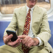 Senior Businessman Using Mobile Phone in the Subway Train — Stock Photo #53559015