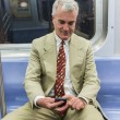 Senior Businessman Using Mobile Phone in the Subway Train — Stock Photo #53559205