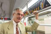 Empresario senior en el tren subterráneo — Foto de Stock