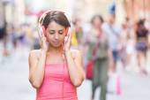 Woman Listening Music in City — Stock Photo