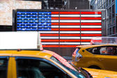 United States Flag and Yellow Cabs — Stock Photo