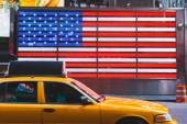 United States Flag and Yellow Cab — Stock Photo