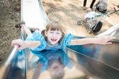 Little Girl Playing on Slide — Stockfoto