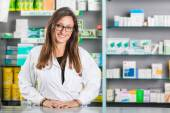 Beautiful Pharmacist Portrait in a Drugstore — Stock Photo