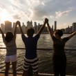 Happy Tourists with Raised Arms — Stock Photo #54415251